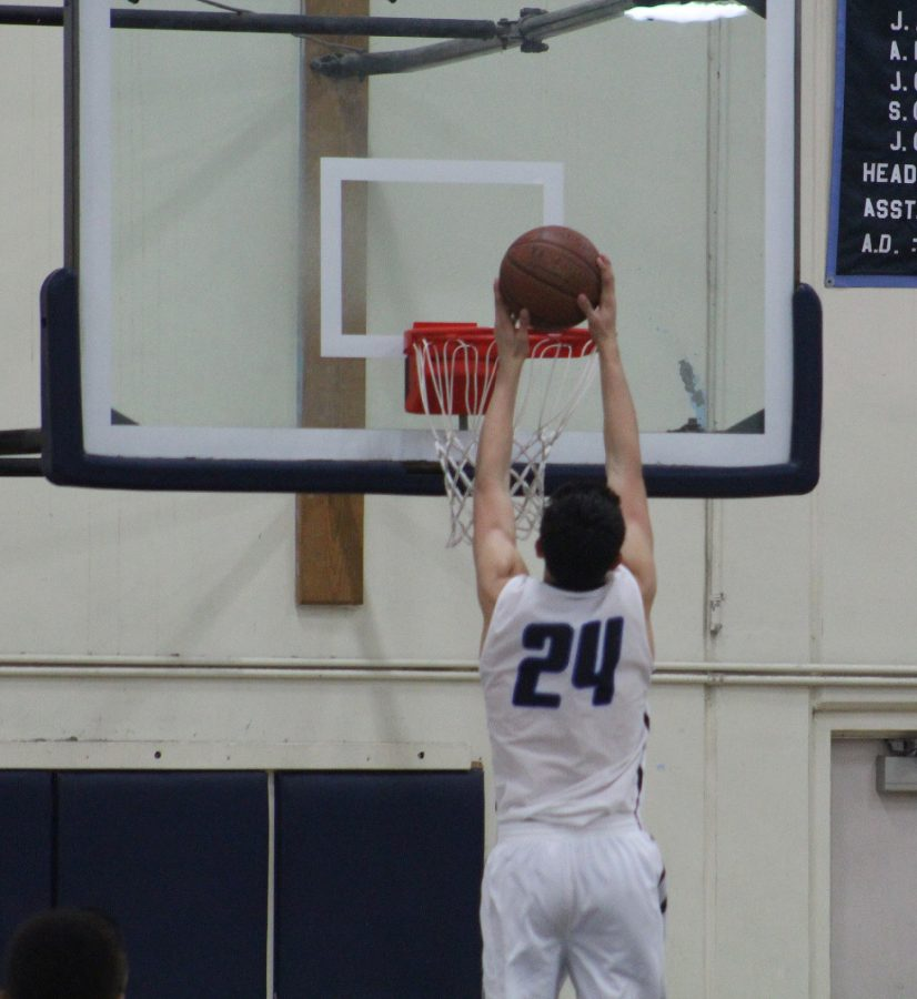 Freshman, Jaime Jaquez, shooting an alley-oop during the forth quarter.