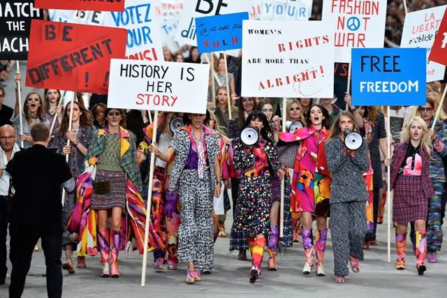 Chanel+models+walk+the+catwalk+in+a+finale+featuring+empowering+signs+and+megaphones.