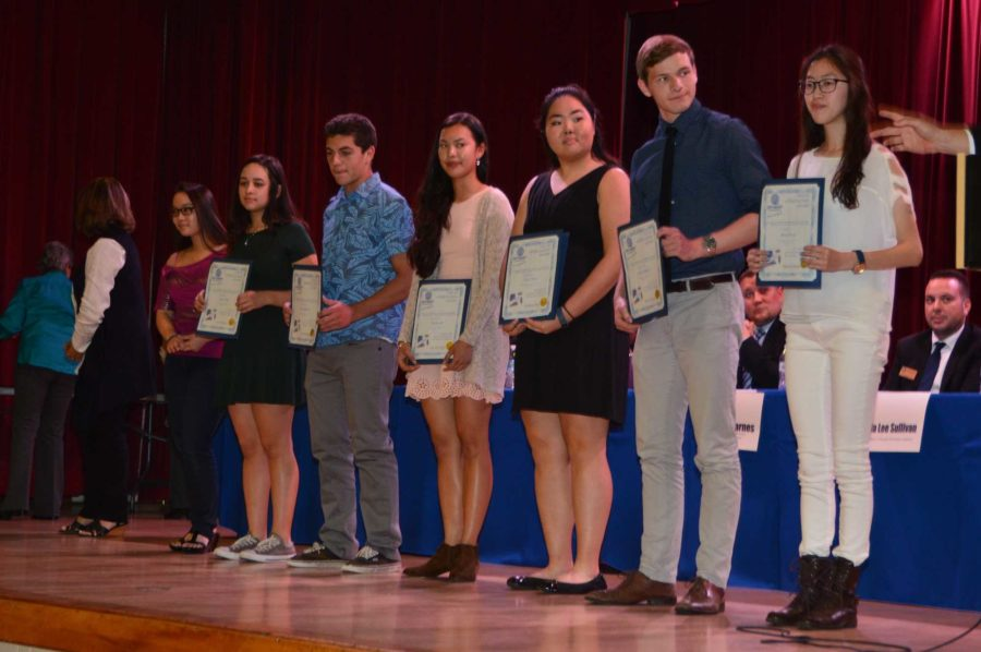 Students with their awards at the Optimist Club dinner.