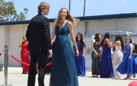 Kiley Borchard (senior) smiles to the crowd as her partner, Brad Kooker (senior), looks on.