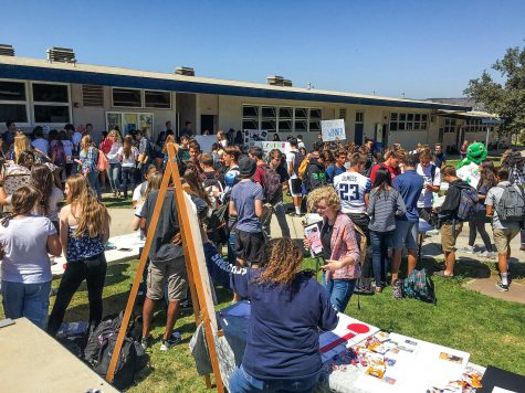 "Hundreds of students ""rushed"" to the quad last Friday, both to advertise and join new Cam High clubs this school year."