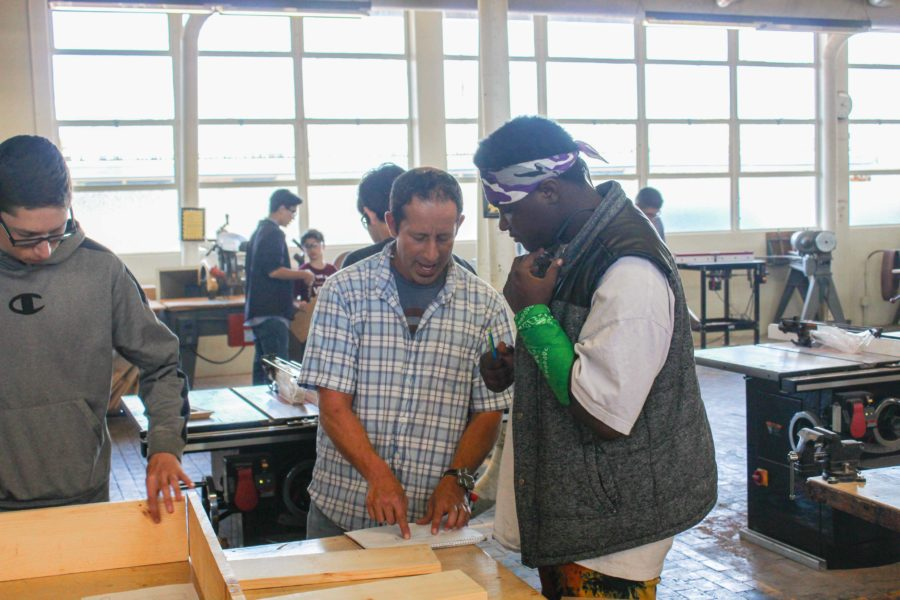 Mr. Peter Watchel, Woodshop teacher, helps a student with a design in class. Watchel is one of several new teachers introduced to Cam High this school year.