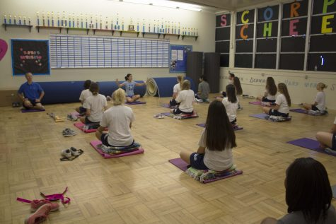 Ms. Claudia Grafenstein teaching yoga to her second period class.