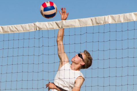 John Paul Dillard, third year beach volleyball player and senior, attacks the ball at a tournament in Ventura Harbor.