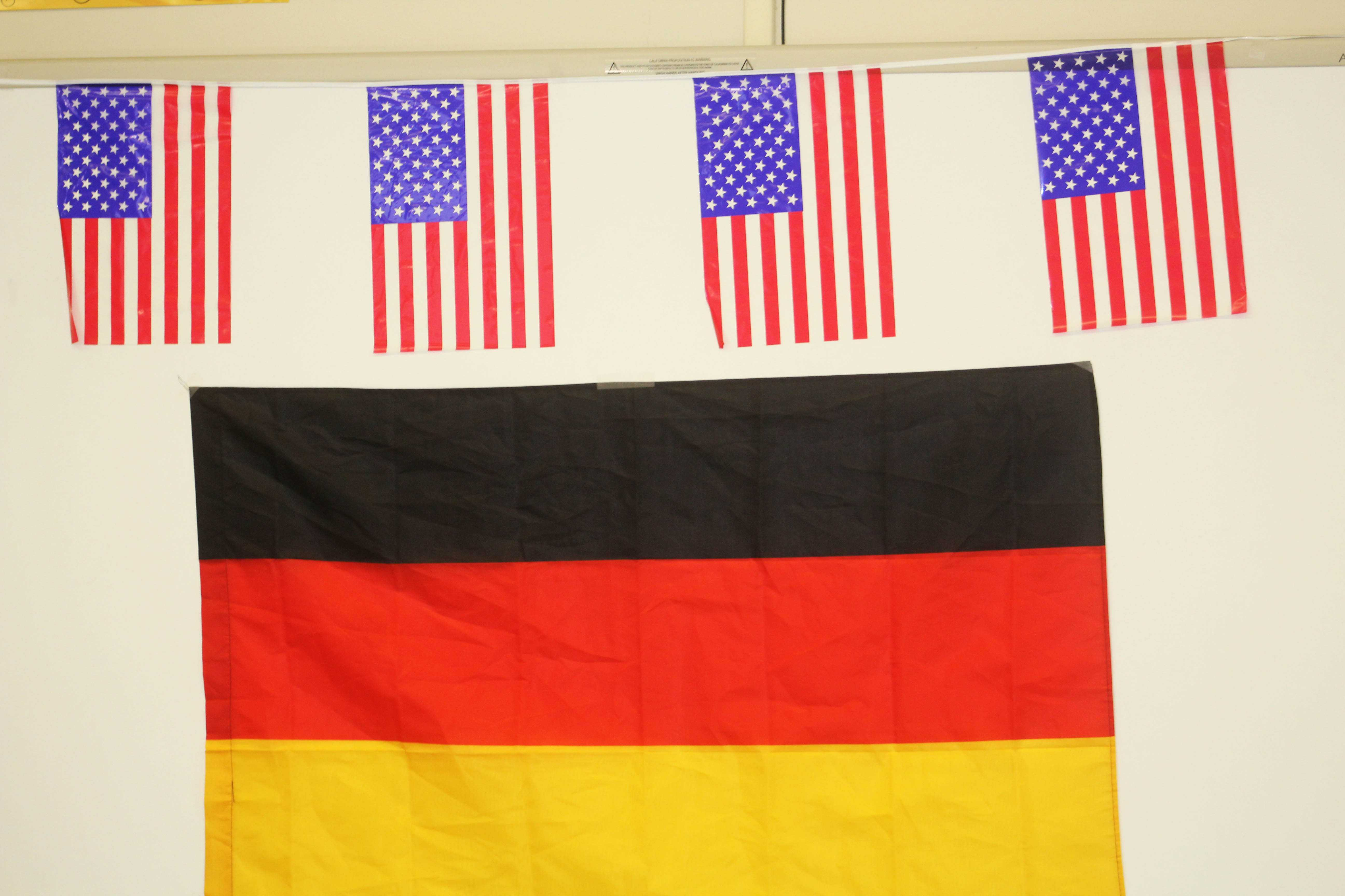 The German and American flags hung up in the German classroom to celebrate the arrival of the German students to Camarillo.