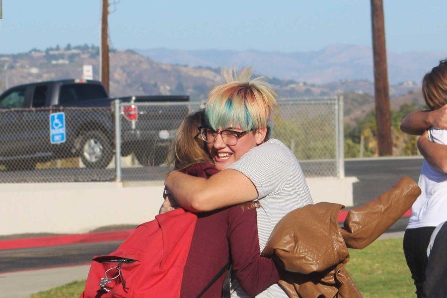 Maddi Boulais, Cam High senior, hugs her German exchange partner, Lea Geißendörfer, for the first time in front of the high school after six months of messaging online.