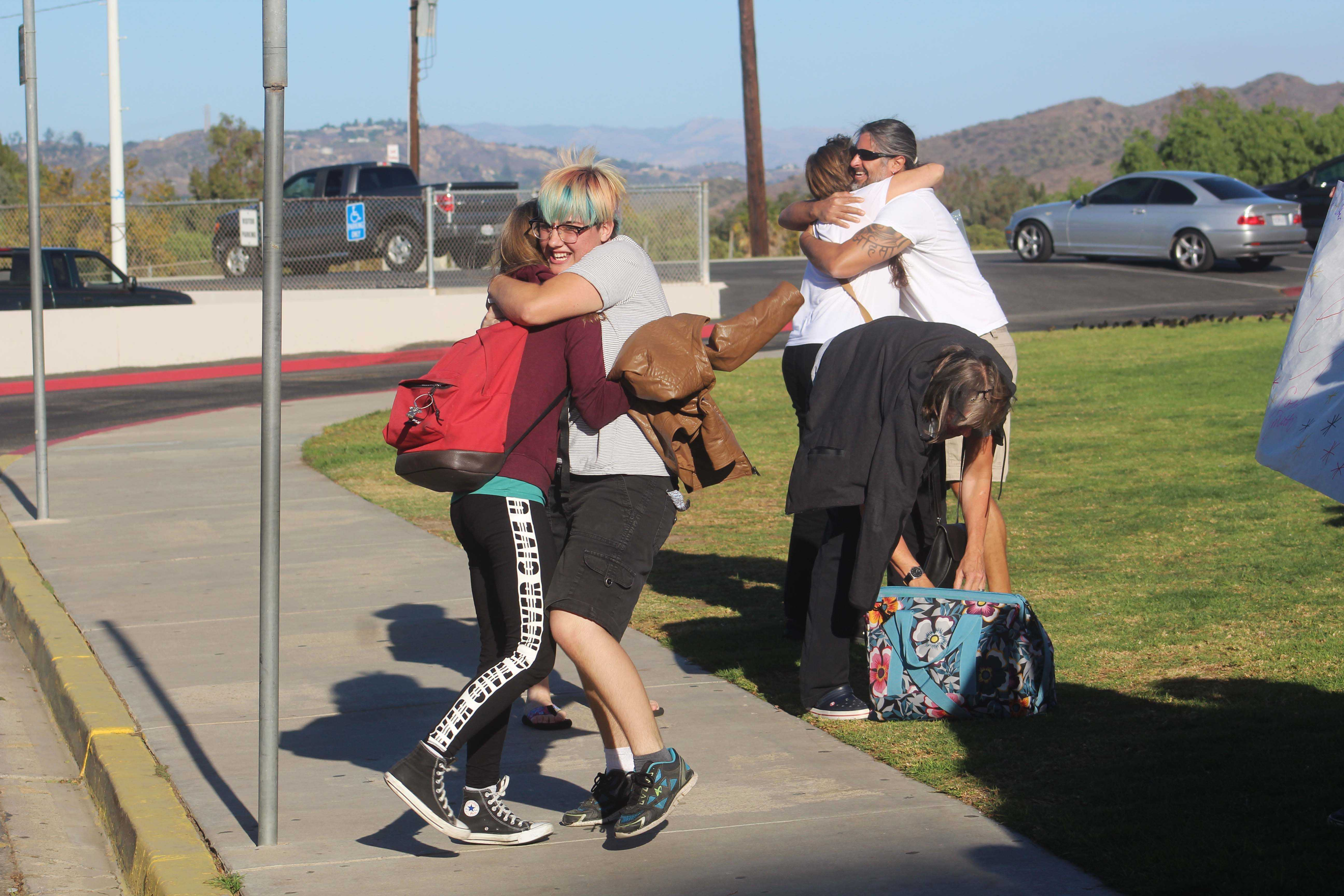 Maddi Boulais, senior, hugs her German exchange partner, Lea Geißendörfer, for the first time in front of the high school. After six months of messaging online, they finally met.