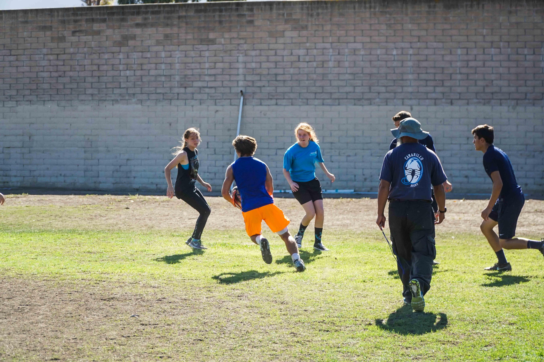 Joshua Marks, senior, avoids an opponent as he tries to score.