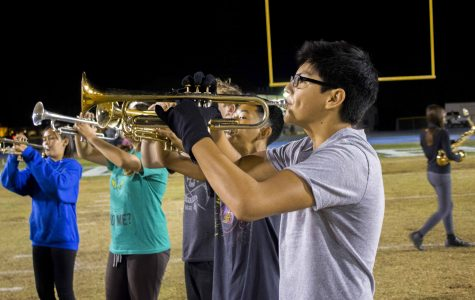 Trumpet player Logan Villalobos, sophomore, rehearsing through the marching band's field show called