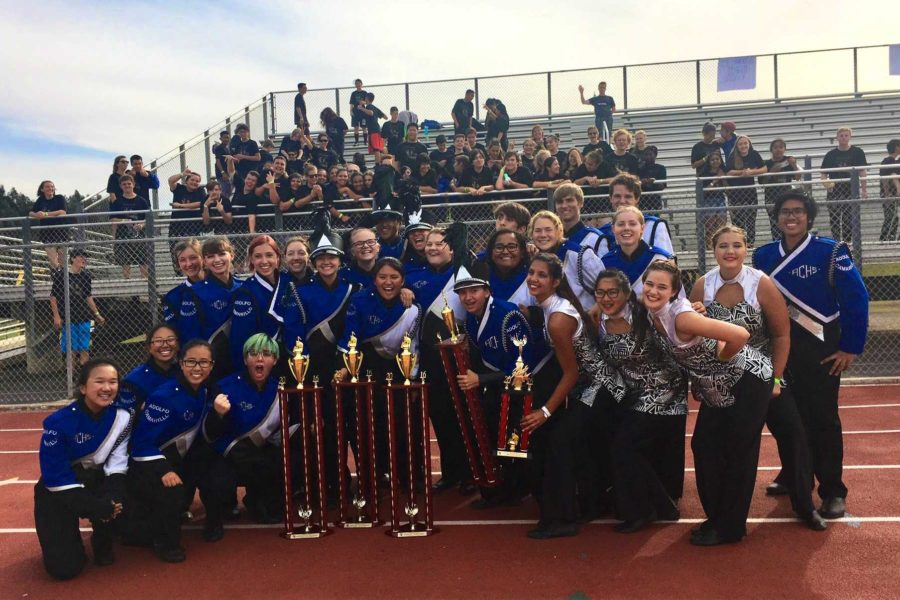 Cam High's marching band posing for a group photo after their victorious Oxnard High School show.