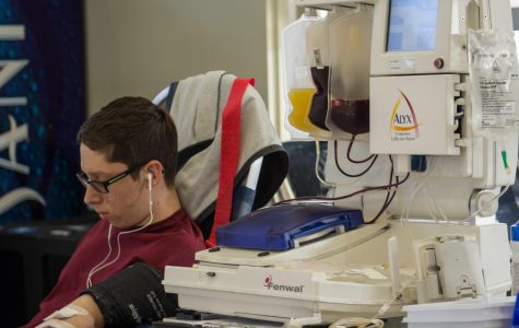 Gabriel Martin, senior, donating his blood at the annual United Blood Services Blood Drive.