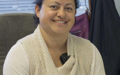 Mrs. Pulido sitting at her desk.