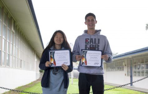 Chun-Tzu Huang and Thomas Huebner (seniors) holding their Pre-Engineering Program certificates of achievement.