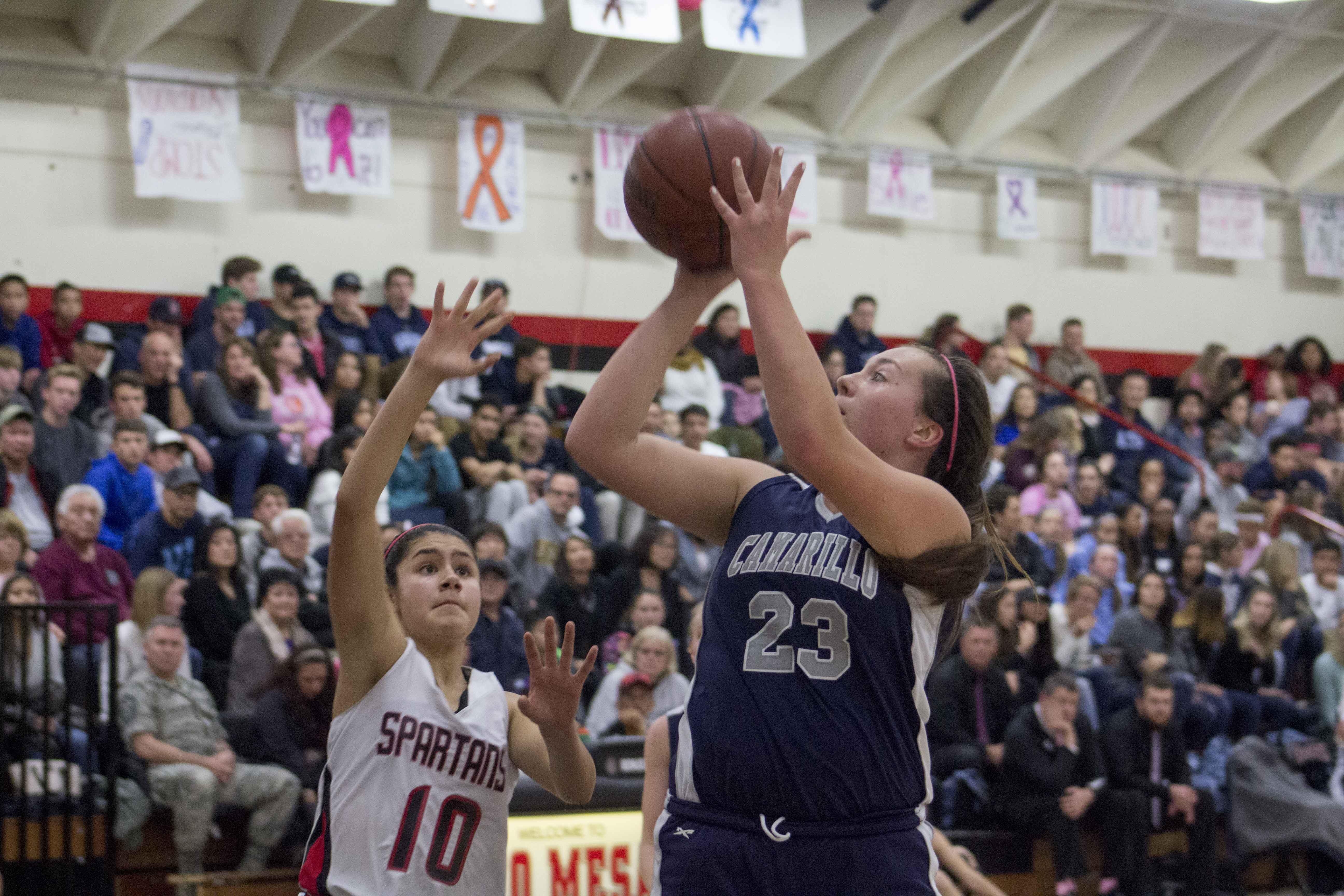 Senior Cameran Bahnsen shoots the basketball over a defender.