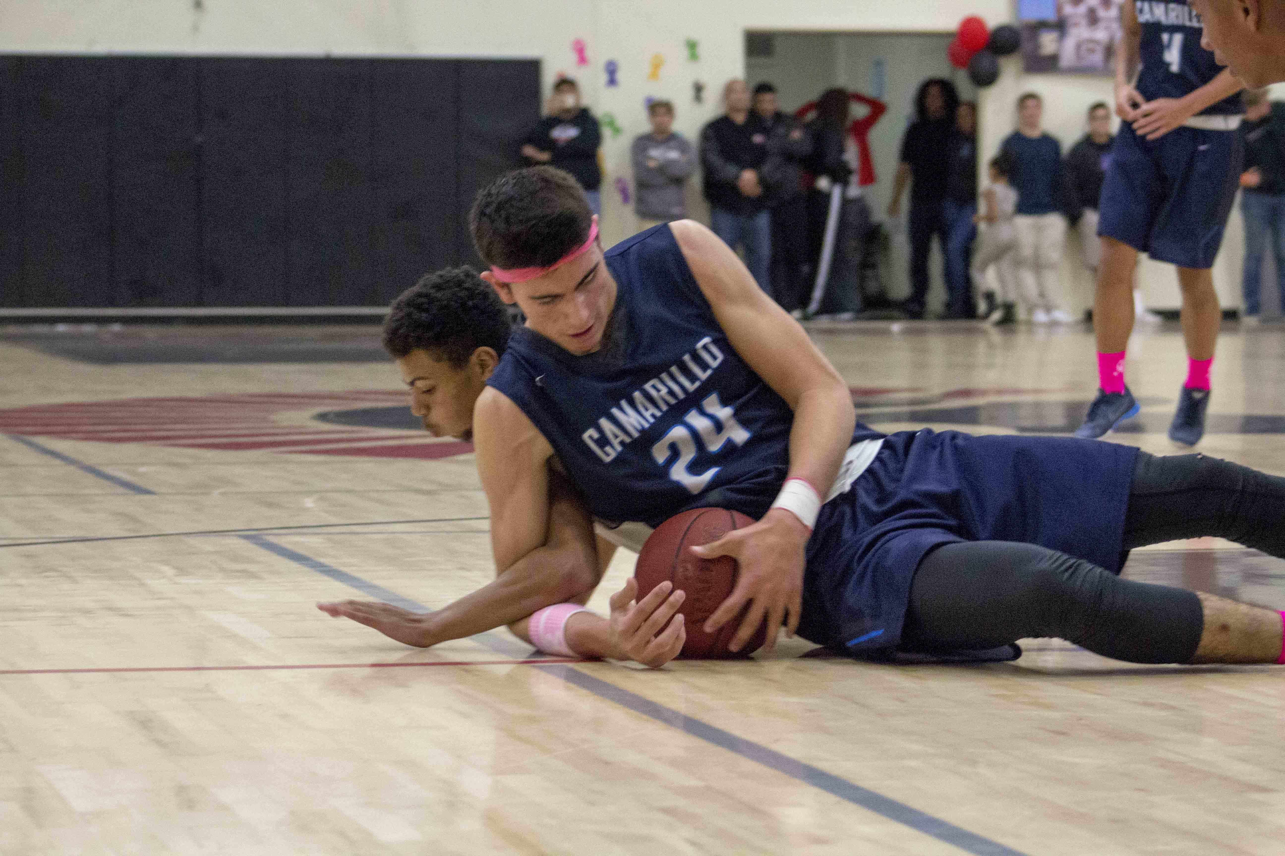 Sophomore Jaime Jaquez Jr. dives for the loose ball.
