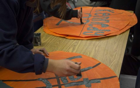 ASB students creating basketball posters for the Cam High varsity basketball players.
