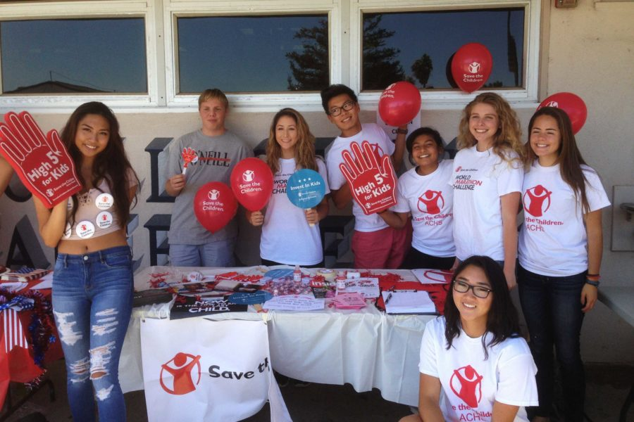 Members of Save the Children promoting their club during Club Rush.
