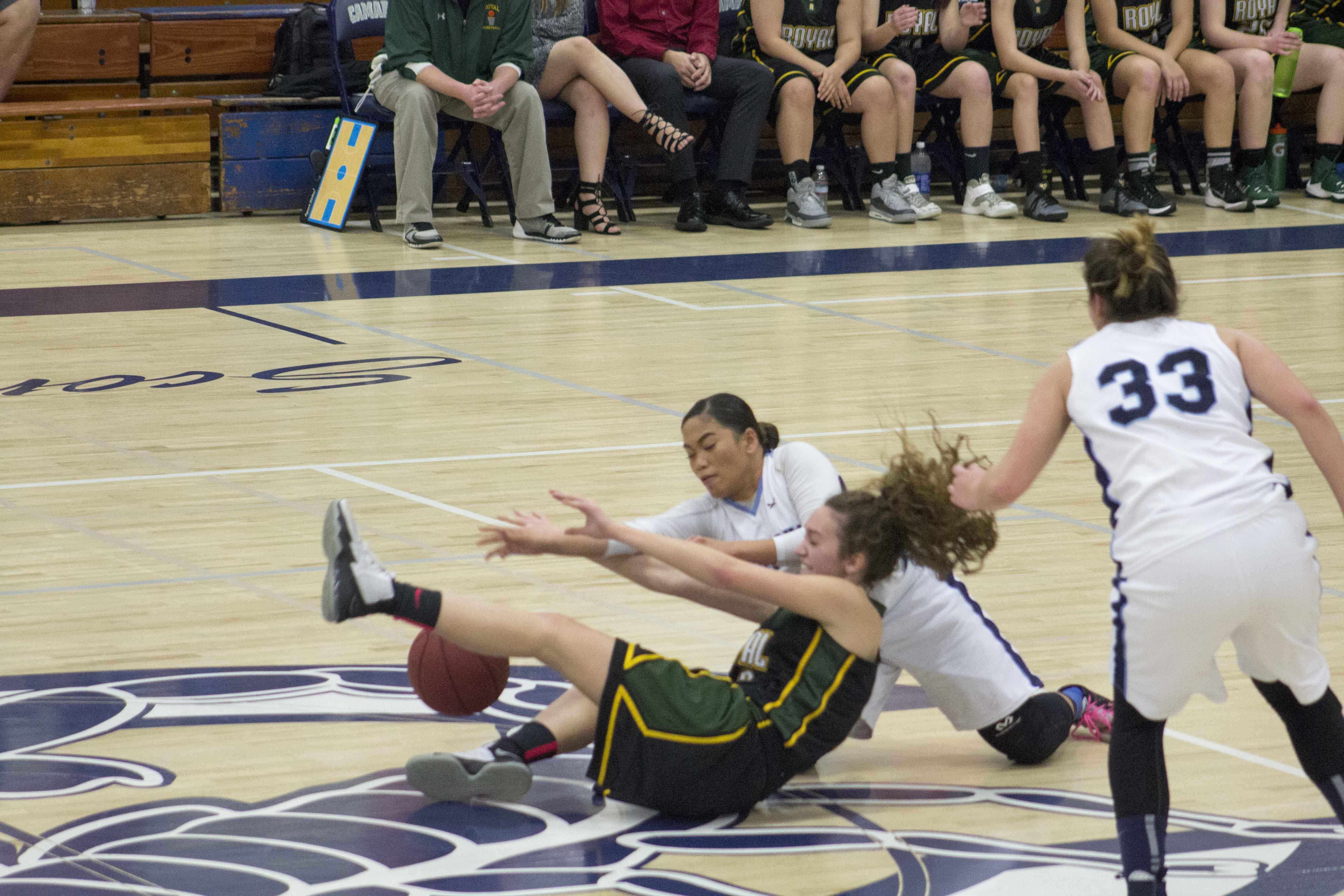 Nikki Puga, senior, dives for the loose ball.