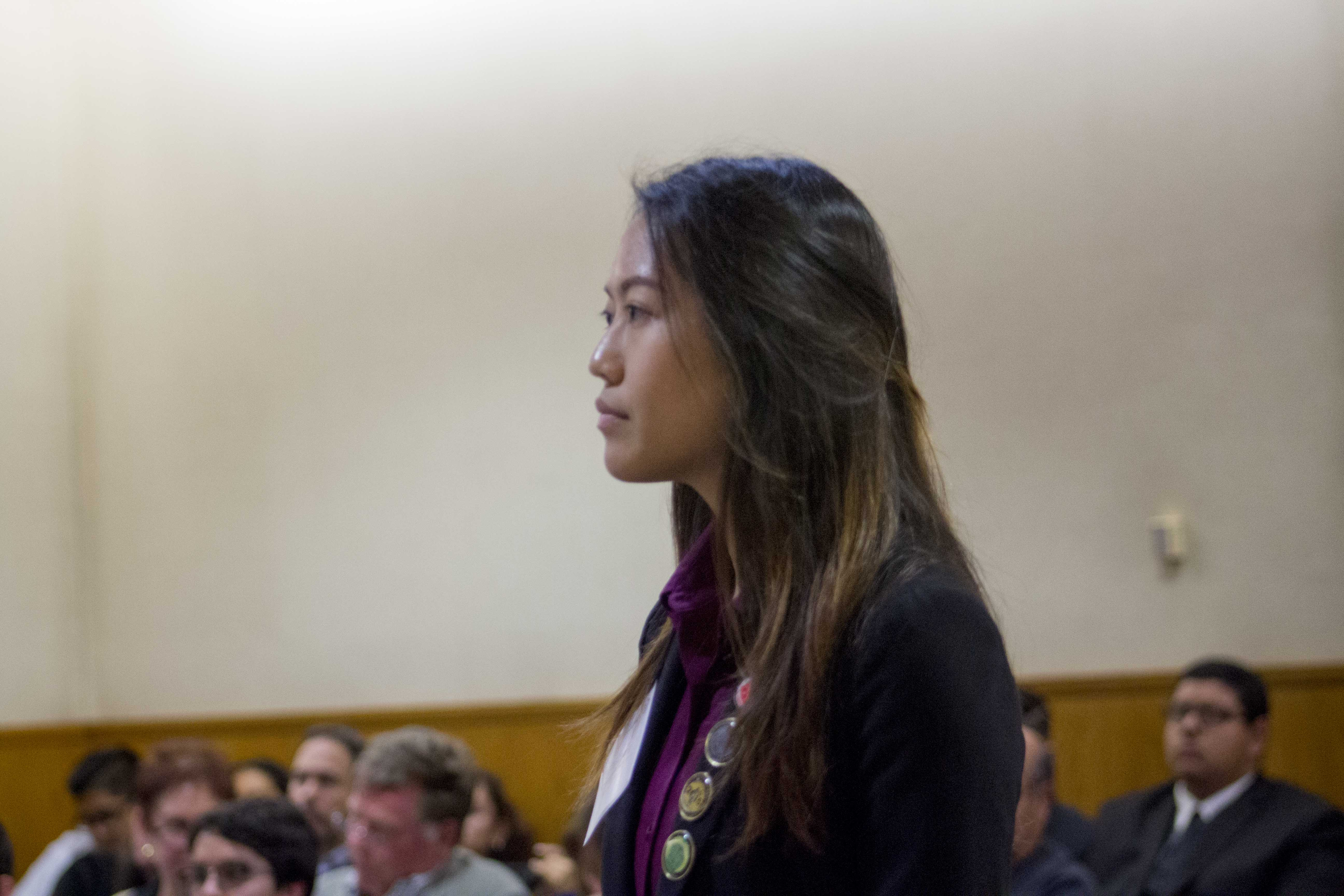 Helen Zhang, senior and prosecution attorney of the A Team, listening to a witness during a mock trial case against Hueneme High School.