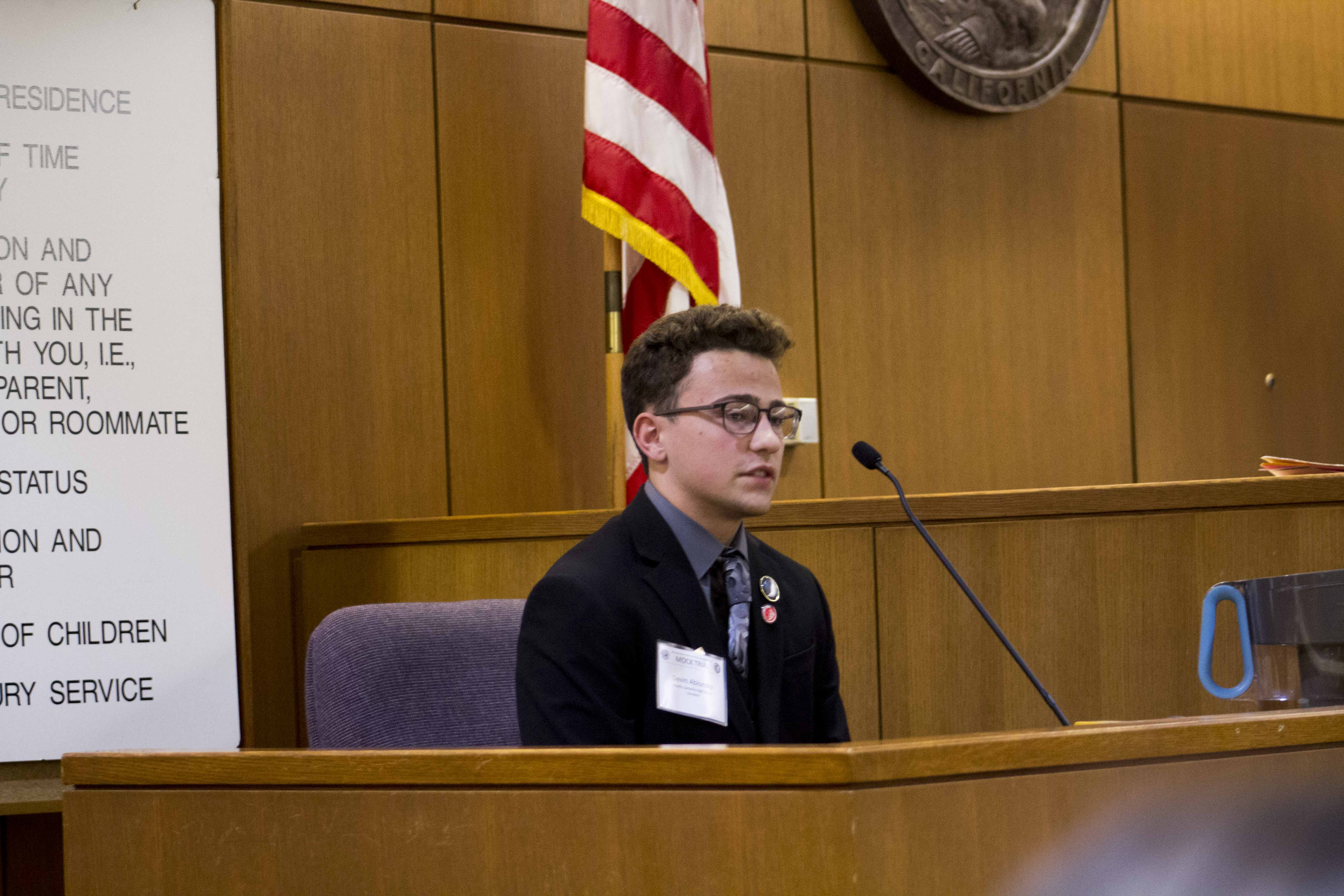 Devin Ablonsky, senior, playing the role of Officer Hayden West on the Mock Trial's A Team.