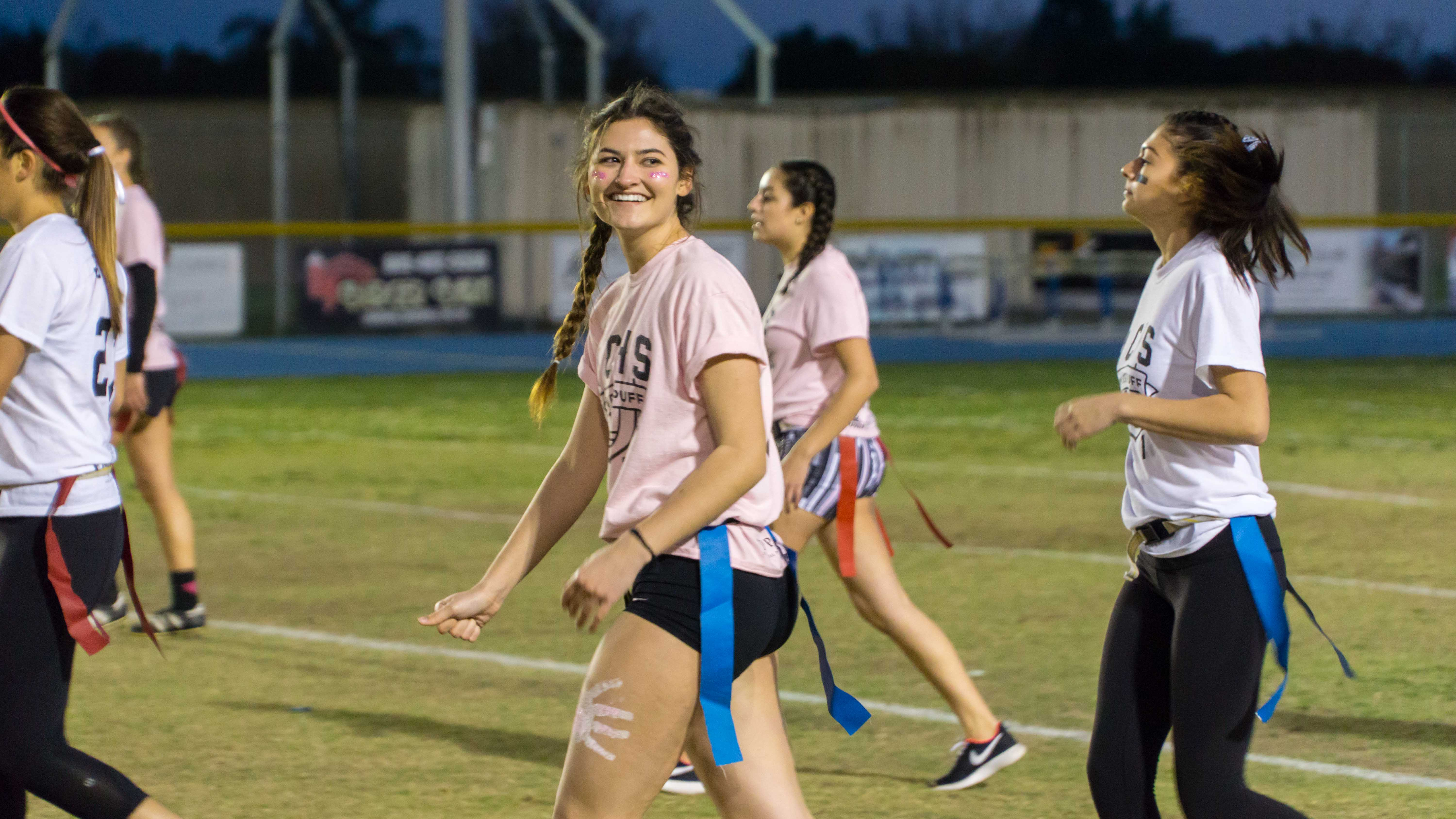 Sydney Means, senior, smiles at her teammates as she walks back to the huddle.