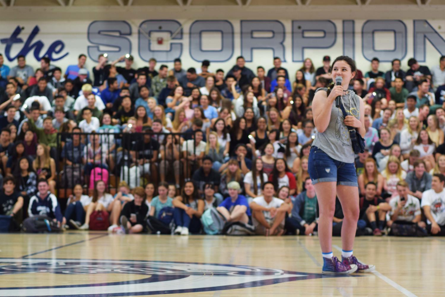 "Abbie Harris, sophomore, sings ""Grenade"" during the High School Nation Q&A assembly."