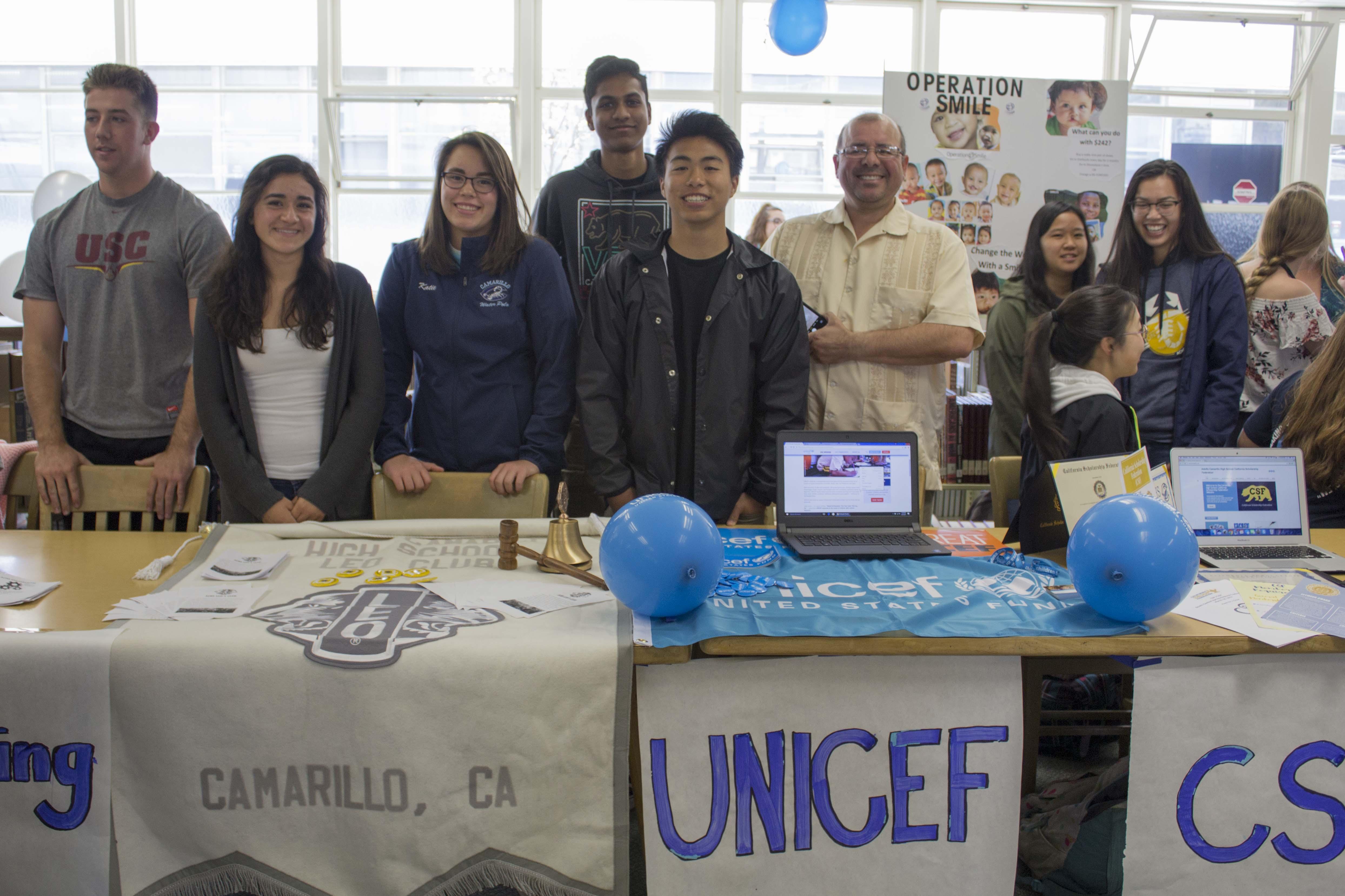 Andrea Banales and Katie Rodriguez, seniors, representing Leo's Club and Aditya Sunkara, Ben Abutin, juniors, and Mr. Jesus Duran representing UNICEF.