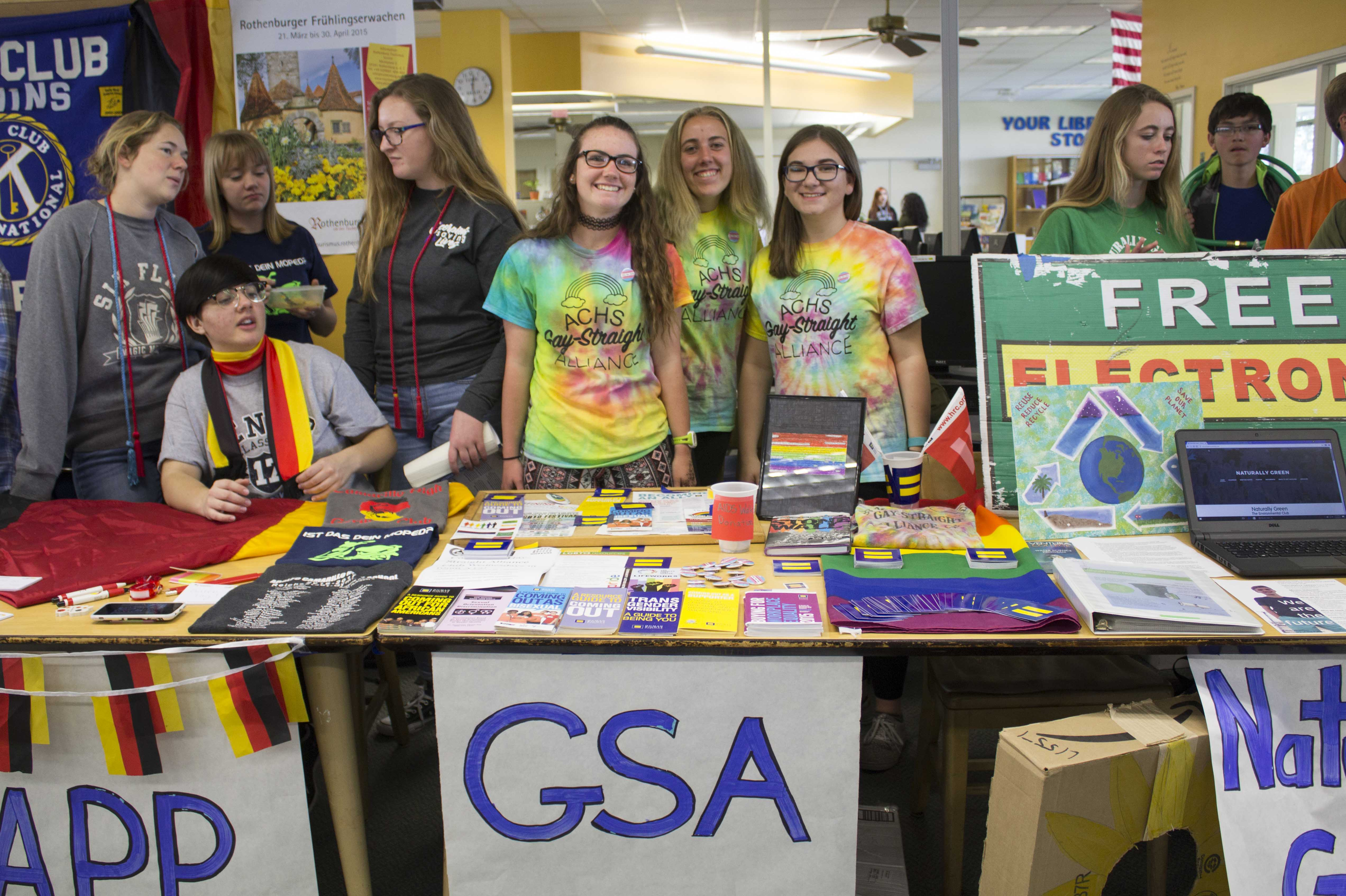 Tasha Stuart-Shuman, senior, Bella Roske, sophomore, and Carly Nigh, junior, from Gay-Straight Alliance, a club that promotes equality for all students on campus.