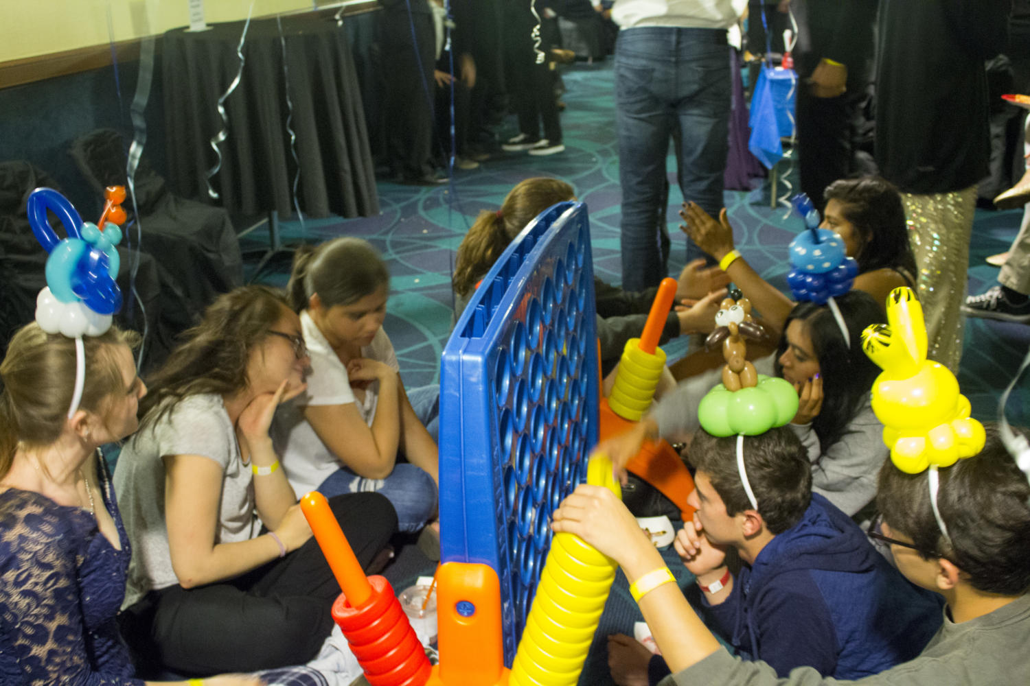 Students playing a game of Connect 4 at the annual After Prom after party.