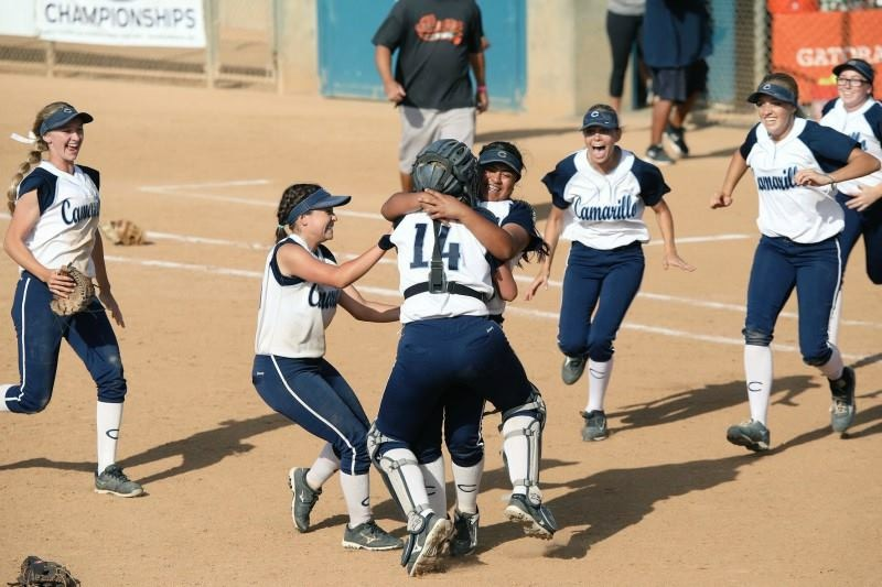 Senior+Savanna+Salyer-Kovacs+hugs+freshman+Eryka+Gonzales+in+celebration+of+a+Cam+High%27s+Girls%27+softball+team+state+championship+as+they+beat+Riverside+Poly+4-0.