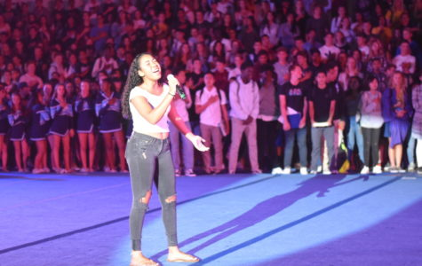 Deanna Baxter, junior, sings the National Anthem at this years' first school rally.