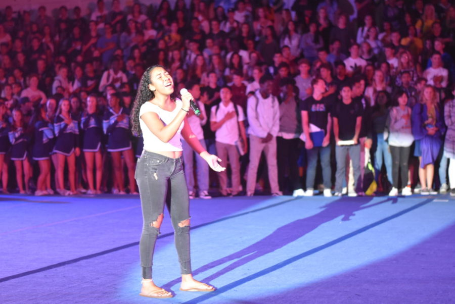 Deanna Baxter, junior, sings the National Anthem at this years