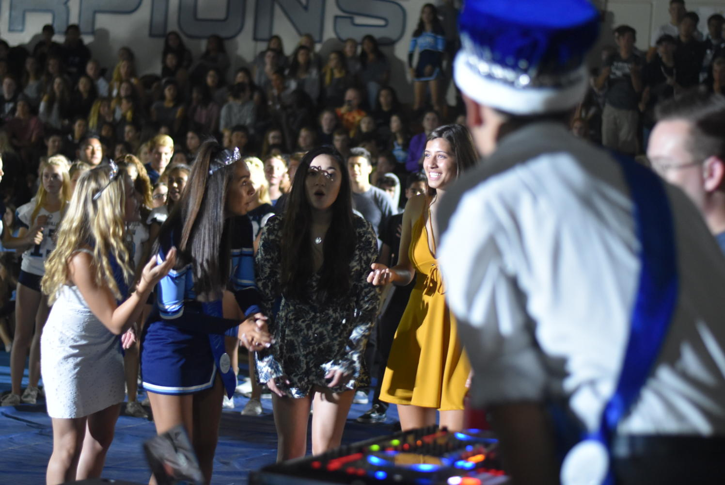 "The female half of homecoming royalty excitedly try to guess what song is playing during ""Guess the Song""."