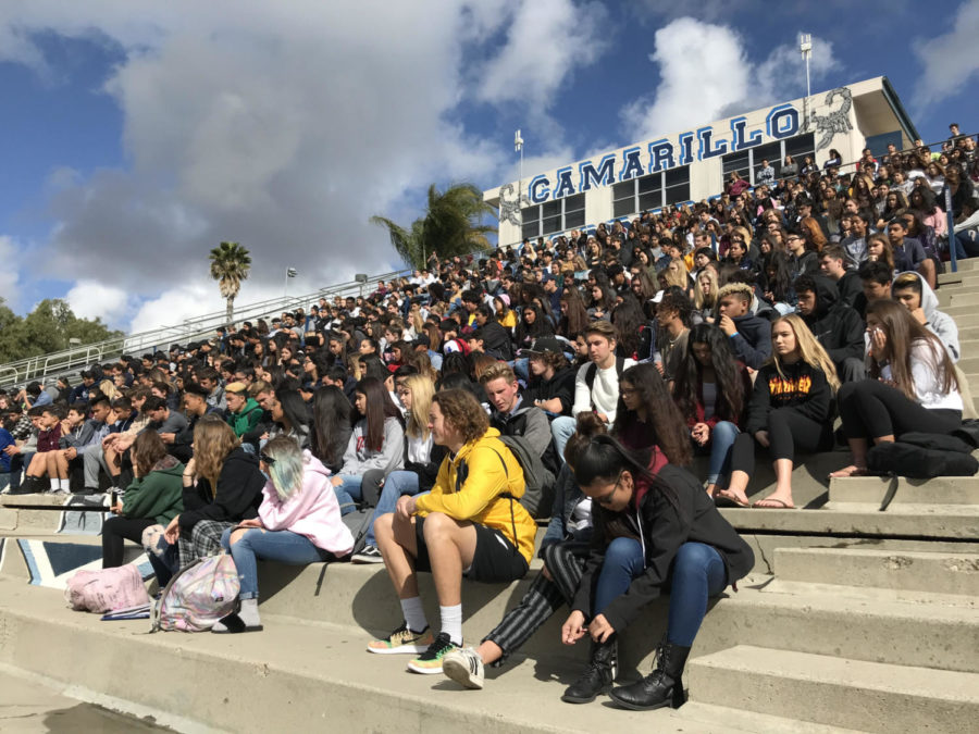 Students+attend+the+walkout+on+March+24+by+gathering+in+the+stadium+to+honor+the+victims+of+the+Parkland+shooting.+