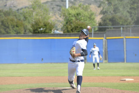 Photo by: Gabi Jose  Pitcher and senior Gabe Baldovino throwing a pitch against Sierra Canyon.