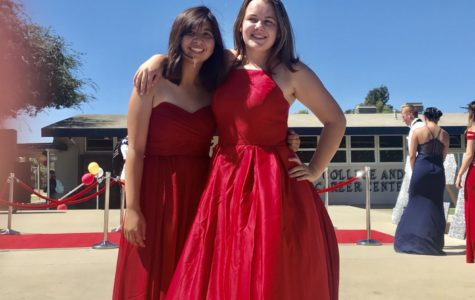 Assistant Drum Majors Katelyn Raney and Kaylie Pritchard pose for a picture after the Homecoming Fashion Show.