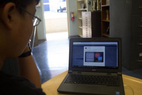 Staff Writer Edward Wang visits the #OUStuVoice Twitter page.  Photo by: Ian Lattimer