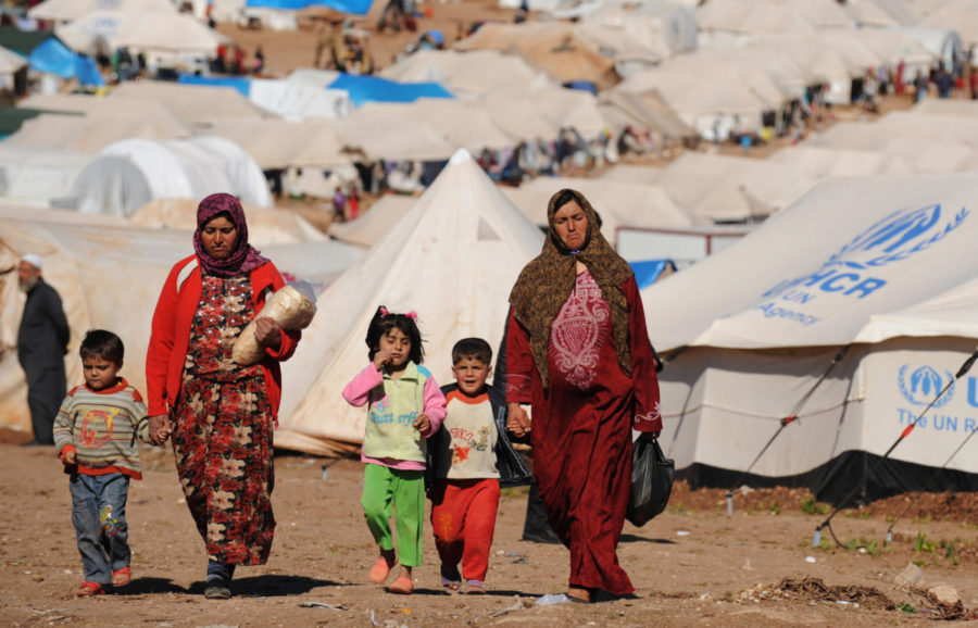 Syrian internally displaced people walk in the Atme camp, along the Turkish border in the northwestern Syrian province of Idlib, on March 19, 2013.   Photo provided by: Bulent Kilic/Getty Images
