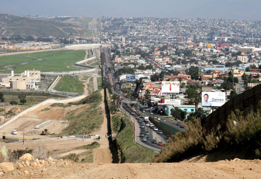 A small fence separates densely populated Tijuana, Mexico (right) from the United States in the Border Patrol's San Diego Sector.