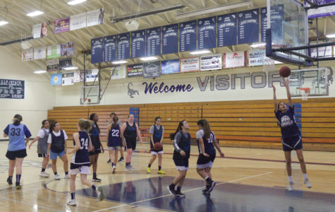 Girls Basketball practicing at the Cam High gym.