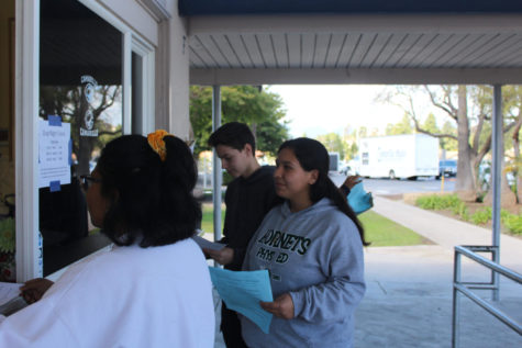 Students purchasing AP tests on March 7, 2019. From left to right Gabrielle Domingo, Victoria Paniagua, and Adrian Wasylewski.