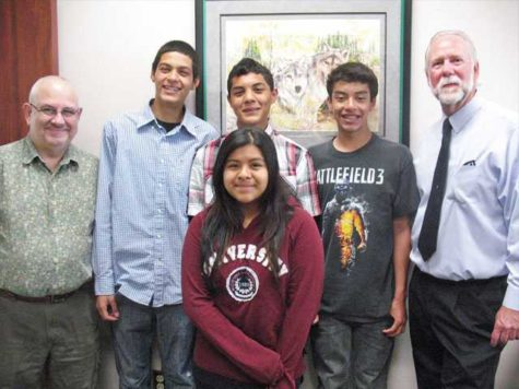 From left to right, Geoffrey Aronsky, students Alejandro Hernandez and Christian Rodriguez, Principal Pete Fries, and student Marisela Sanchez.