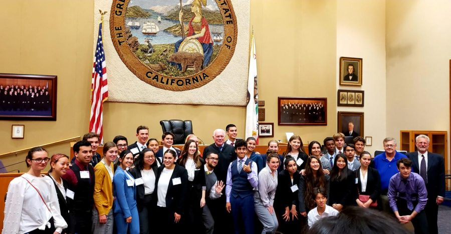 Cam High's Mock Trial team poses for a picture after finishing a round.
