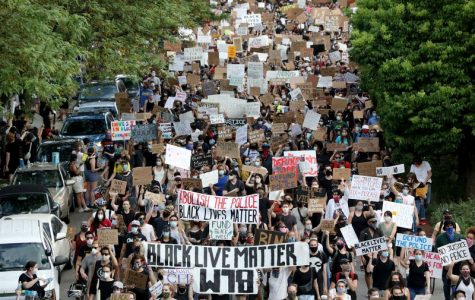 Protesters march in the streets of Chicago to protest police brutality and racism in America.